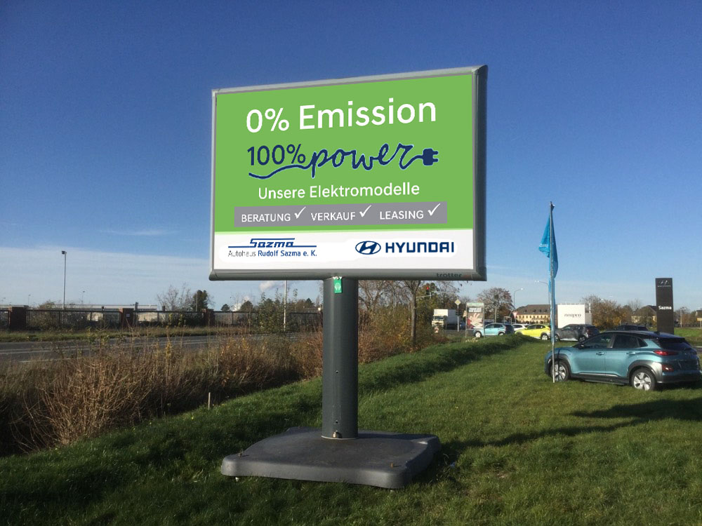 Kampagne autohaus sazma zero emission trotter aussenwerbung werbeflache 1 1000x750